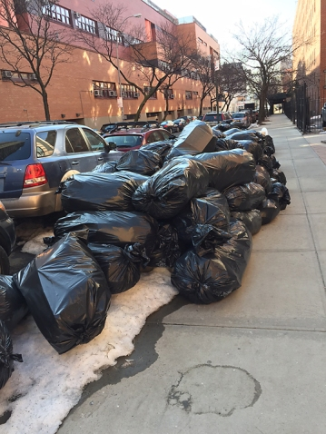 Bags on the sidewalks accumualte following the snow.