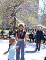 Blowing bubbles in Washington Sq.