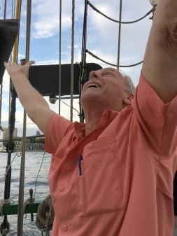 Celebrating the hoisting of the sails! - Photo by Joyce Wright