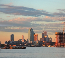 The golden hour slipped over Brooklyn as the barges took their place.