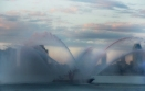 FDNY Water boats spewed colored streams of water in the East River