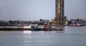 Tugs moved Macy's barges into place